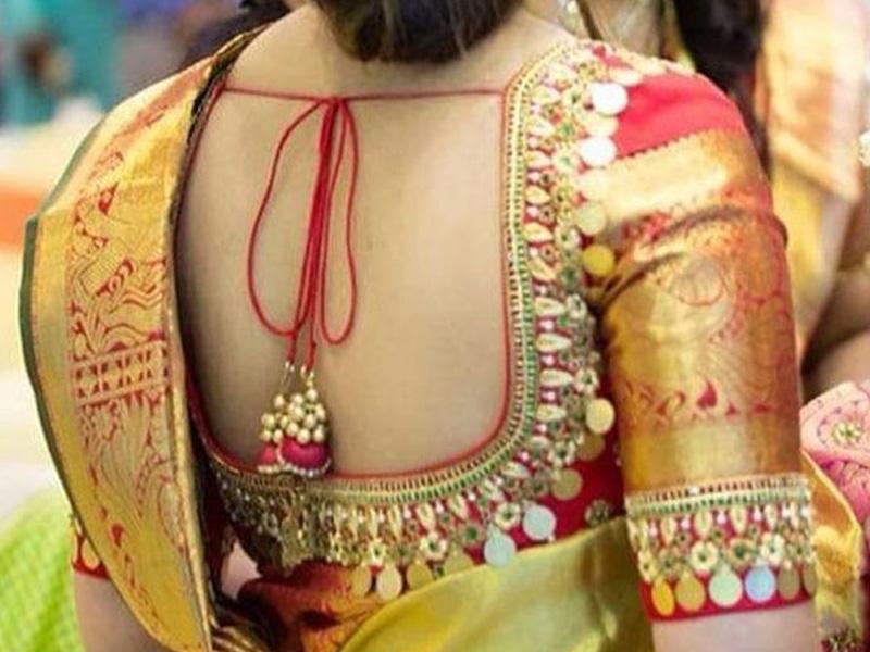 woaman wearing  back embroidery saree blouse