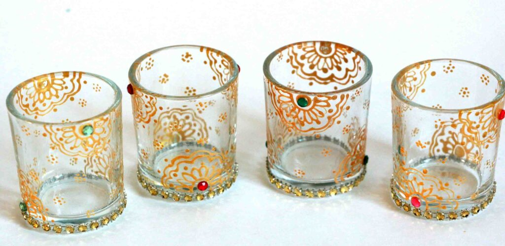 candles in a decorated glass