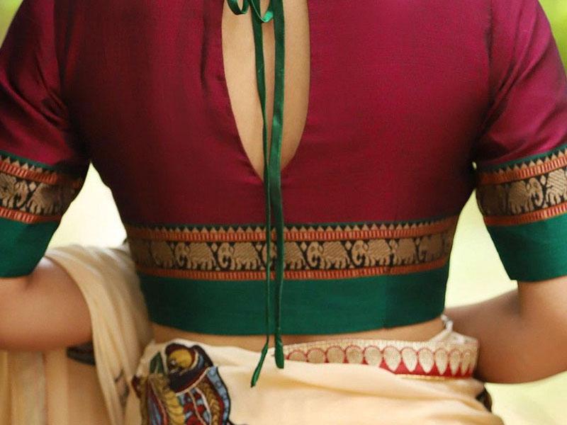 woaman wearing red colour  designer saree blouse
